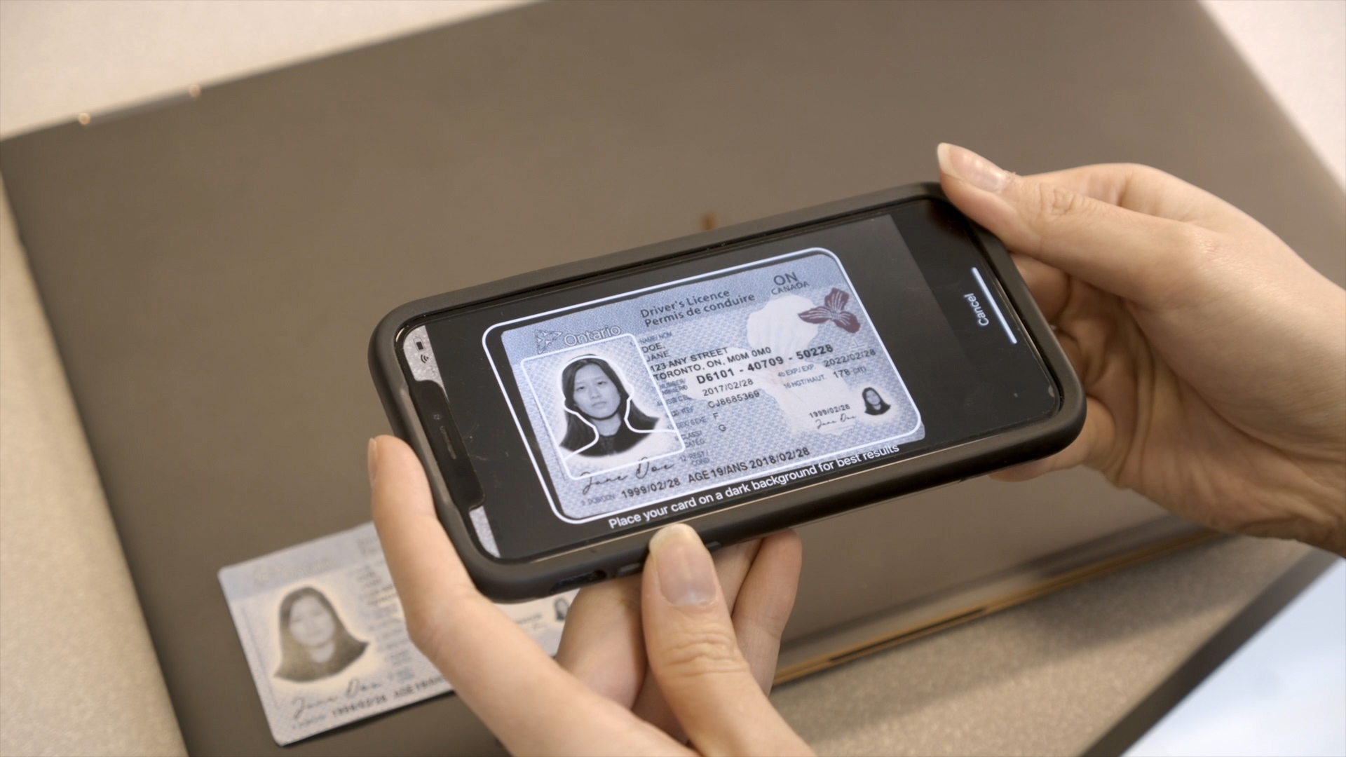 Scanning a driver's licence ID card with a mobile phone.